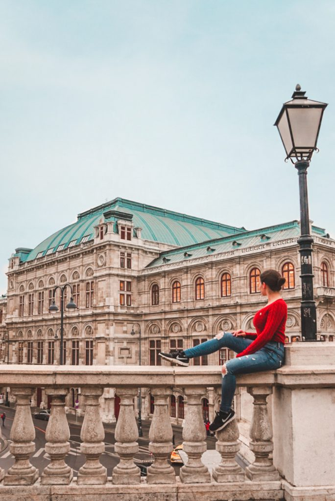 Girl sitting in front of the Vienna State Opera | Best Photo Spots in Vienna
