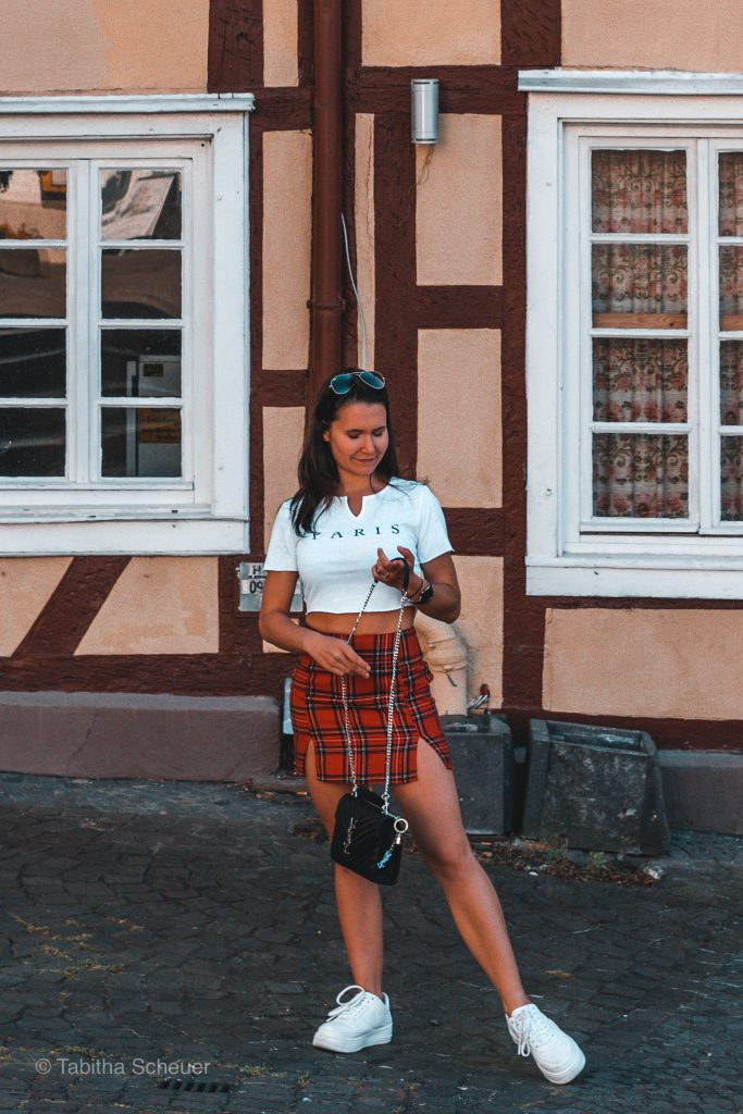 Girl standing in front of half-timbered houses in Germany