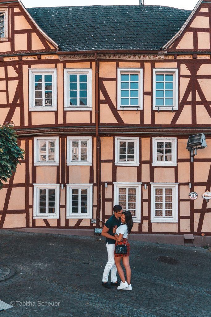 Travel Couple from Germany posing in front of a half-timbered house in Linz am Rhein
